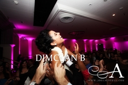 orange county wedding dj djmc ian b bride being lifted up
